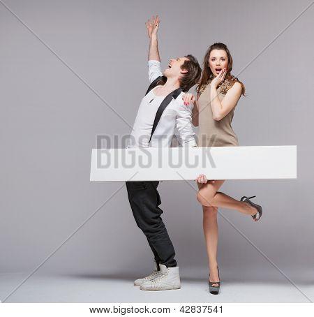 Happy couple with advert