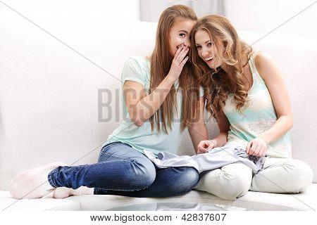 Women whisper