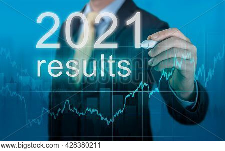2021 Economic Results Review. Businessman Writes 2021 Results On Virtual Screen. Last Year Review In
