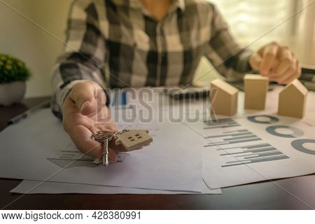 The House Broker Or House Realtor Agents Give The House Keys To The Customers After They Have Agreed
