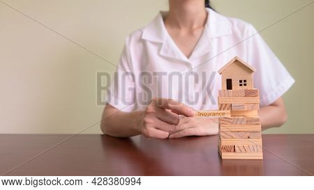 Concepts Of Home Insurance And Asset Risk. Insurance Agent Put Wooden Block With Message