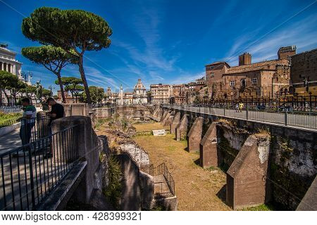 Rome, Italy - Juny, 2021: Ancient Ruins Of Imperial Forum In Rome, Via Dei Fori Imperiali.