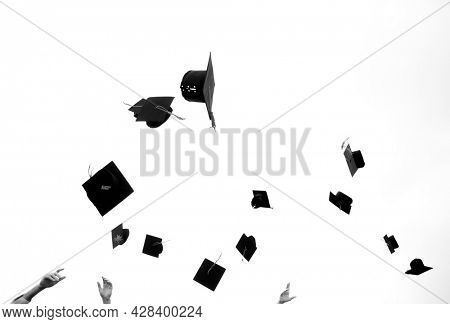 Mortar boards in the air at a graduation