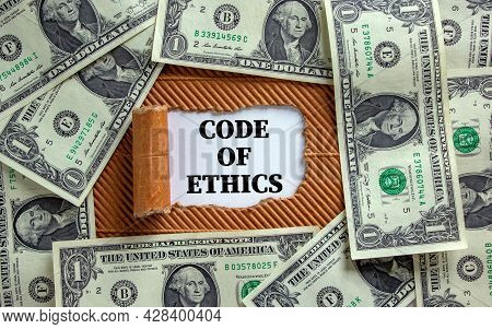Code Of Ethics Symbol. Words 'code Of Ethics' Appearing Behind Torn Brown Paper. Beautiful Backgroun