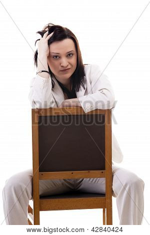 Caucasian Businesswoman In A White Suit Sitting On A Chiar Isolated On White