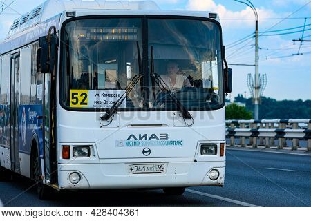 Voronesh, Russia - July, 18, 2021: a city bus follows a route in Voronezh, Russia