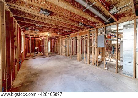 Wooden Foundation Inside An Unfinished Basement Of A House