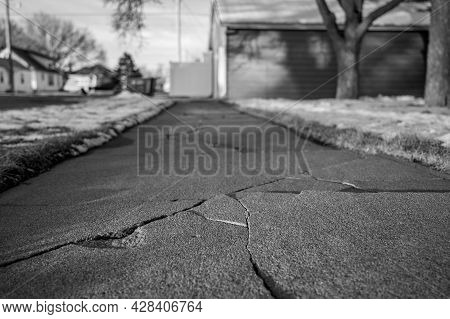 Frost Heave Crack In Residential Concrete Sidewalk