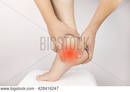 The Man Is Experiencing Acute Pain In The Heel. Achilles Tendon Sprain. Foot Injuries. Heel Spur, Mu