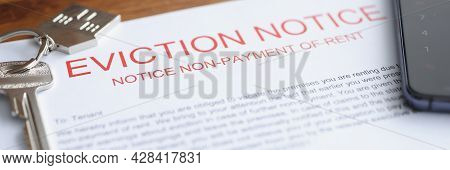 Document On Eviction From Housing For Non-payment Lies On Table With Keys