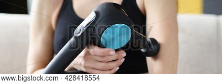Young Woman Doing Massage Relaxing Massage For Hands In Vibrating Massager