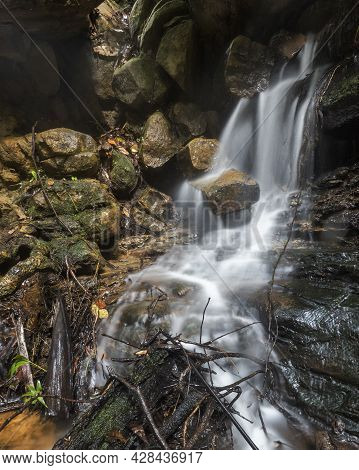 A Hidden Waterfall Covering The Rocks On Nsw Central Coast