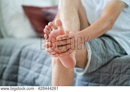 Foot Pain, Man Suffering From Feet Ache