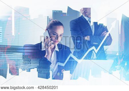 Concentrated Businesswoman Sitting At The Desk In Front Of Laptop And Taking Participation At Confer