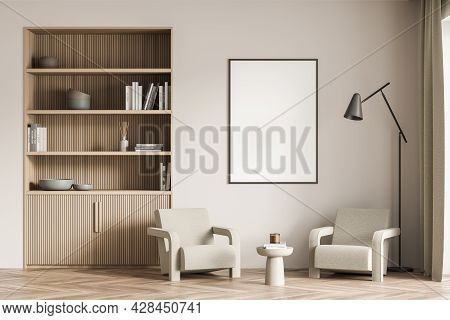 Empty White Banner In The Beige Living Room, Having Wooden Niche Bookcase, Two Armchairs With Coffee