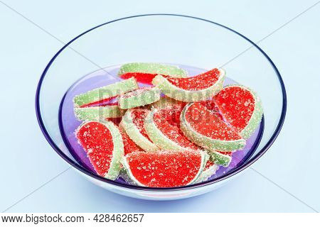 Jelly Candies. Close-up Of Watermelon Jelly Candies In A Translucent Bowl On A Light Blue Background