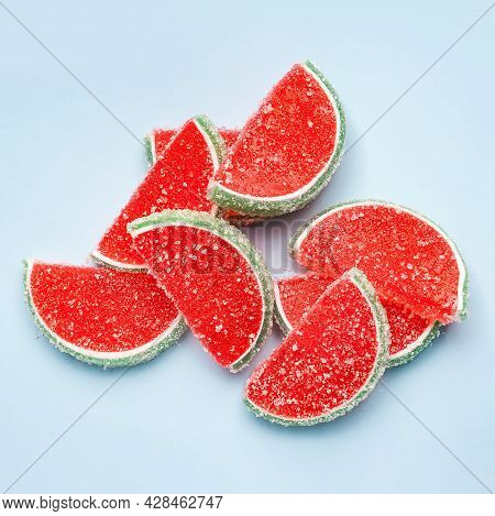 Jelly Candies. Top View Of Watermelon Jelly Candies Sprinkled With Sugar On A Blue Background. Water