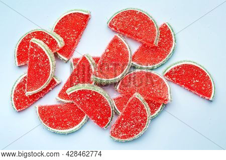 Jelly Candies. Top View Of Jelly Candies Sprinkled With Sugar On A Blue Background. Watermelon Marma