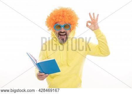 Happy Man In Funky Wig Show Ok Sign Gesture Reading School Book In Geek Sunglasses, Education