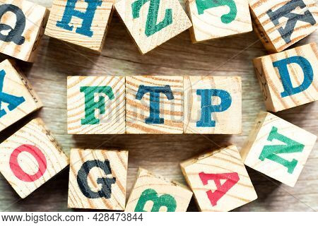 Alphabet Letter Block In Word Ftp (abbreviation Of File Transfer Protocol) With Another On Wood Back