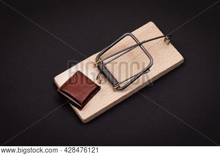 Temptation By Sweets Or Chocolate Addiction - Sweet Wedge Of Milk Chocolate In Wooden Mousetrap On B