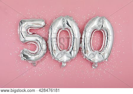 Silver Balloon Showing Number 500 On Pink Background