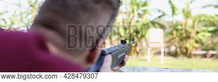 Man Shoots A Weapon At Target In Street Shooting Range