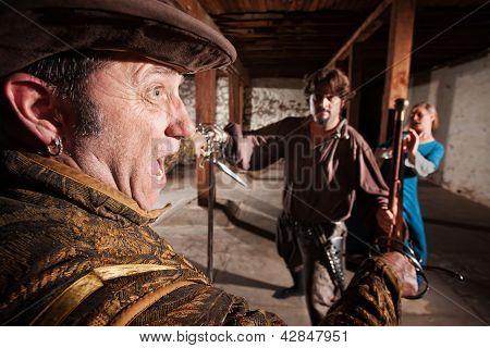 Swordsman Attacking Man And Woman