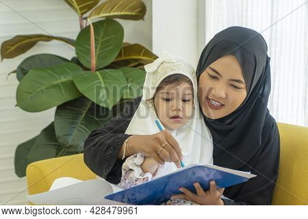 Family Lifestyle Activity Education Concept. Daughter Mix Race Girl Wear Headdress Hijab Learning Wr