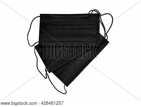 Black Protection Face Mask With Ear Straps. Procedure Mask To Cover Mouth And Nose To Protect From V