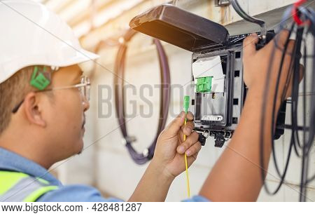 An Internet Technician Is Repairing Or Maintaining A Fiber Optic Connection By Opening A Fiber Optic