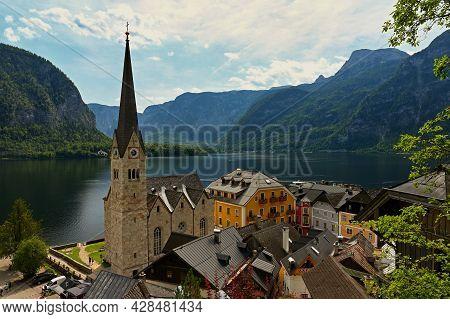 Hallstatt Landscape. Beautiful Mountain Village In The Austrian Alps. Scenic Picture - Postcard View