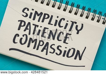 simplicity, patience, compassion - three words from Buddha teaching - handwriting in a notebook, spiritual wisdom concept