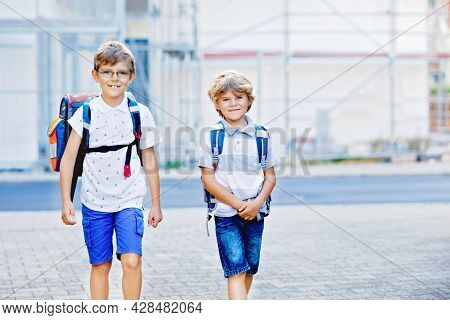 Two Little Kid Boys With Backpack Or Satchel. Schoolkids On The Way To School. Healthy Adorable Chil