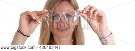 Portre Young Woman With Poor Eyesight Holds Glasses In Hands