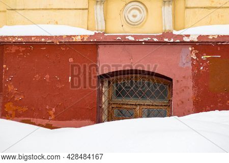 Basement Window With Grating Covered With A Large Layer Of Snow In Winter