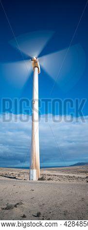 wind turbine in the desert with blue sky  background. wind mill farm in california desert