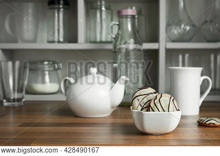 White Teapot With Tea Cup And Cookies In White Bowl On The Countertop Of A Scandinavian-style Kitche