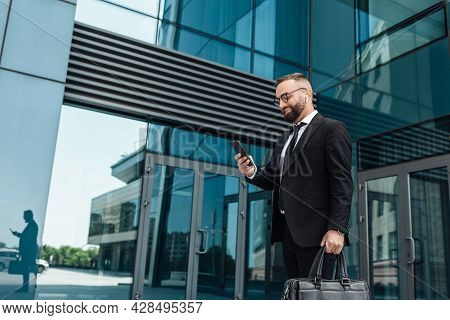 Favorite Music During Break From Job. Smiling Mature Businessman Walking During Break Outdoors, Free