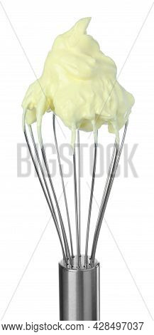 Balloon Whisk With Yellow Cream Isolated On White