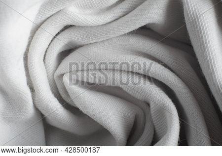 Close-up Of White Rolled Cloth, Macro Photo. Textile Fleecy Texture Background, Top View.