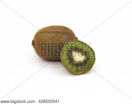 A Cross-cut Slice Of Green Kiwi Isolated On A White Background Next To A Whole Kiwifruit In The Peel