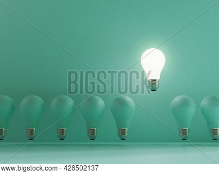 One Lightbulb Shining And Rising Above On Others Bulbs On Blue Background For Outstanding ,different