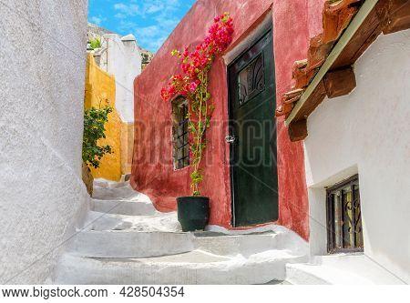 Old Narrow Street In Anafiotika, Plaka District, Athens, Greece. Plaka Is Famous Tourist Attraction