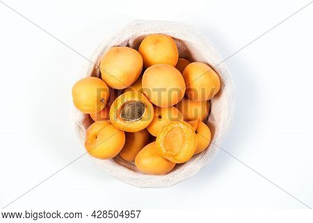 Ripe Apricots On The Table. Orange Apricots Fruits In A Basket. Juicy Apricots Nutrition. Top View