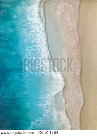 Top View On Sea Wave With White Foam And Light Beige Sand. Fluid, Pour Drawing Of Epoxy Resin. Summe