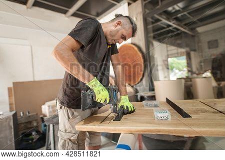 Carpenter Is Making Furniture In A Workshop