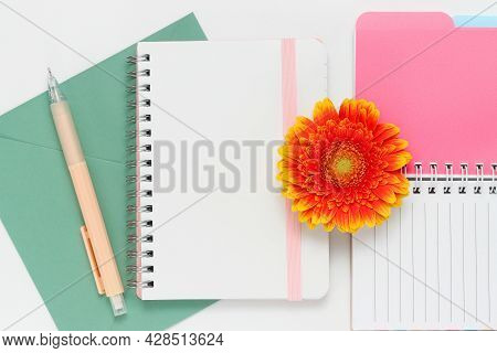 Notepad Sheet With Copy Space For Text With Notepads, Envelope, Pink Pen And Gerbera Flower, Letter