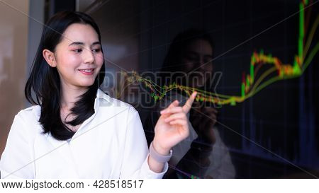 Businesswoman Pointing Chart Financial Market Trader. Concept Of Stock Market, Cryptocurrency.