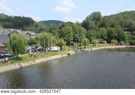 Vresse-sur-semois, Belgium, 22 July 2021: People Enjoying A Warm Summers Day On The Banks Of The Sem